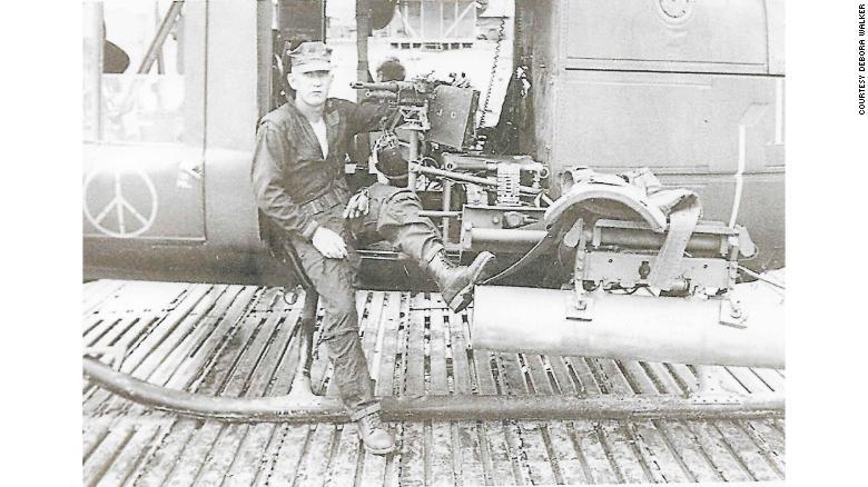 Cox as a helicopter door gunner in the Vietnam War.