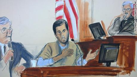 In this courtroom sketch, Turkish-Iranian gold trader Reza Zarrab, center, testifies before Judge Richard Berman, right.