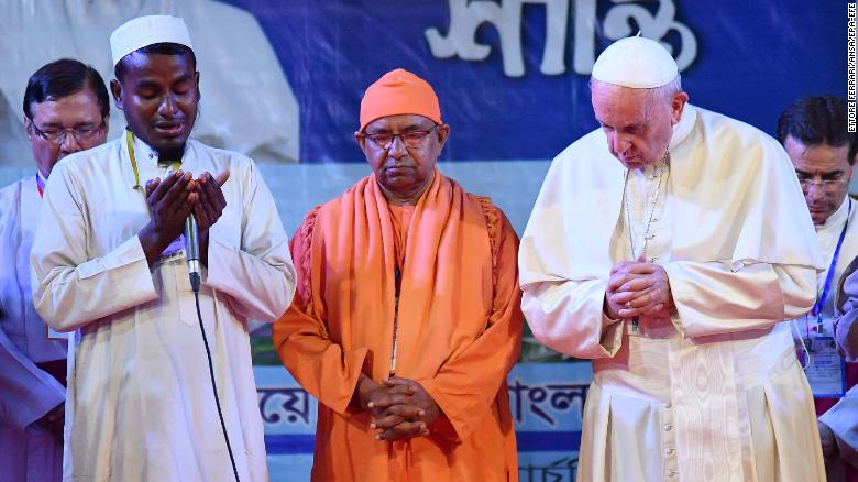 """Pope Francis prays with Rohingya refugees during an interfaith peace meeting in the garden of the Archbishop of Dhaka's residence in Bangladesh's capital on Friday, December 1. Francis visited Myanmar and Bangladesh this week, meeting with leaders in both countries to discuss the <a href=""""http://www.cnn.com/2017/09/13/asia/gallery/rohingya-refugee-crisis/index.html"""" target=""""_blank"""">Rohingya crisis</a>. He <a href=""""http://www.cnn.com/2017/12/01/asia/pope-bangladesh-myanmar-intl/index.html"""">referred to Myanmar's persecuted Rohingya Muslim minority by name</a> Friday for the first time during his Asia tour."""