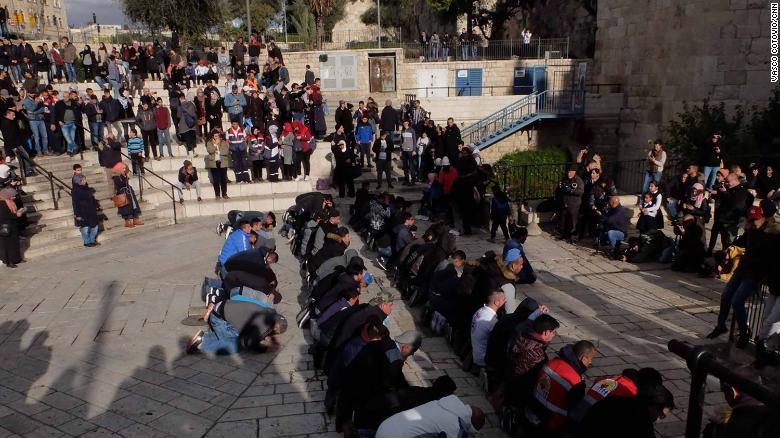 Muslims pray at the Damascus Gate entrance to Jerusalem's Old City on Thursday.