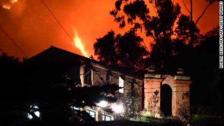 The Thomas Fire burns Monday in the hills above homes in Montecito in Santa Barbara County.