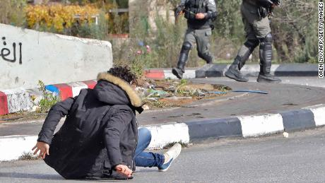 Israeli forces shoot at a Palestinian man after he allegedly stabbed a soldier in al-Bireh on Friday.