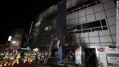 Firefighters make their way into a building on December 21, 2017 in Jecheon, South Korea.