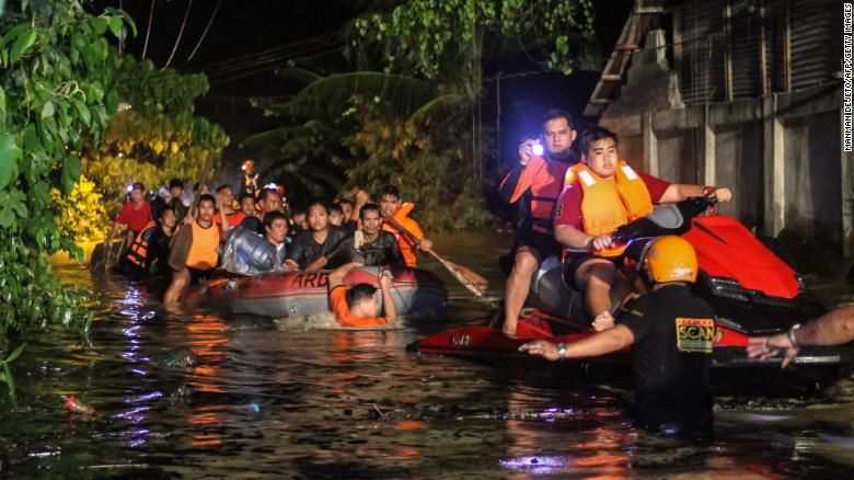 "Rescue workers evacuate residents in Davao on the southern Philippine island of Mindanao early Saturday, December 23, after <a href=""http://www.cnn.com/2017/12/23/asia/philippines-tropical-storm-tembin/index.html"" target=""_blank"">Tropical Storm Tembin</a> dumped heavy rains on the area. Tembin is the Philippines' second deadly tropical storm in a month."