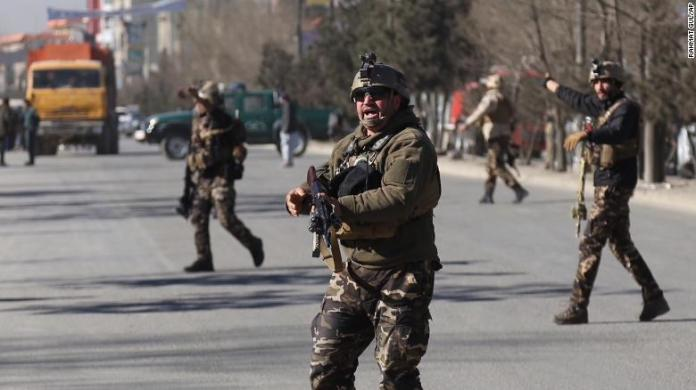 Security personnel arrive at the site of the attack on Thursday.