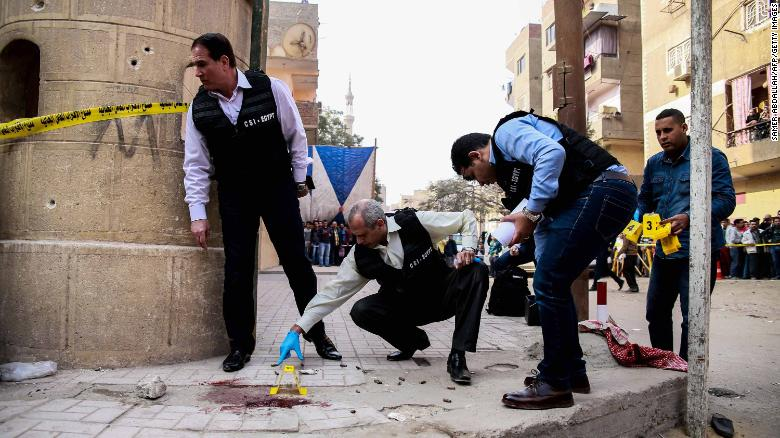 Egyptian officials inspect the site of Friday's attack.