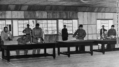 Lieutenant General William K Harrison and Senior Communist Delegate General Nam Il during the signing of the Korean Armistice in Panmunjom on July 27, 1953.
