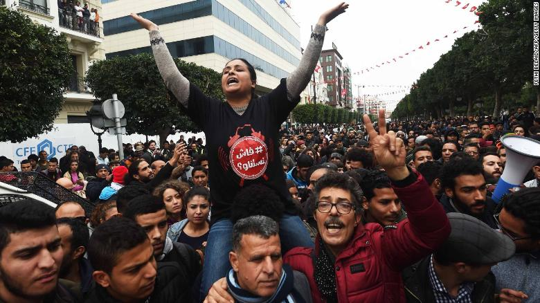 Tunisians shout slogans during a demonstration against the government and price hikes Tuesday in Tunis.