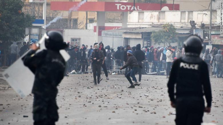 Tunisian protesters clash with security forces in the town of Tebourba on Tuesday.