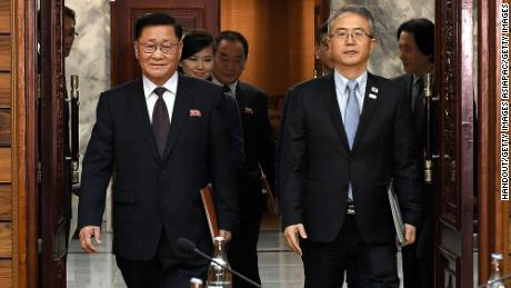 Moranbong member Hyon Song Wol seen with North and South Korean officials on January 15, 2018.