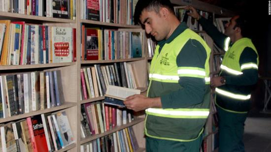 Garbage collectors in Ankara, Turkey browse for books at a library made up entirely of abandoned books.