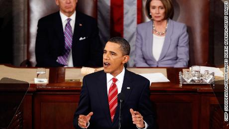 Vice President Joseph Biden and Speaker of the House Rep. Nancy Pelosi look on as President Barack Obama speaks to both houses of Congress during his first State of the Union address on January 27, 2010 in Washington, DC.