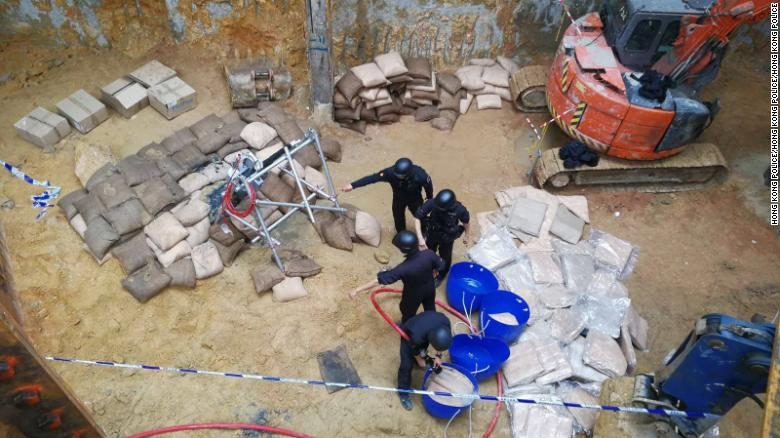 Hong Kong police work to defuse a World War II-era bomb found in the city's Wan Chai area.