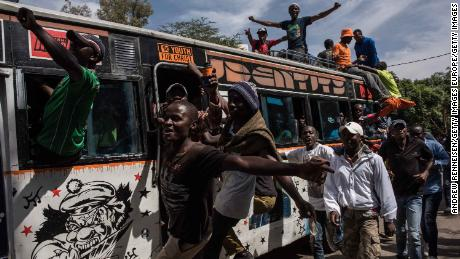 """Jubilant opposition supporters demonstrate prior to a mock """"swearing-in"""" ceremony of presidential candidate Raila Odinga on January 30."""
