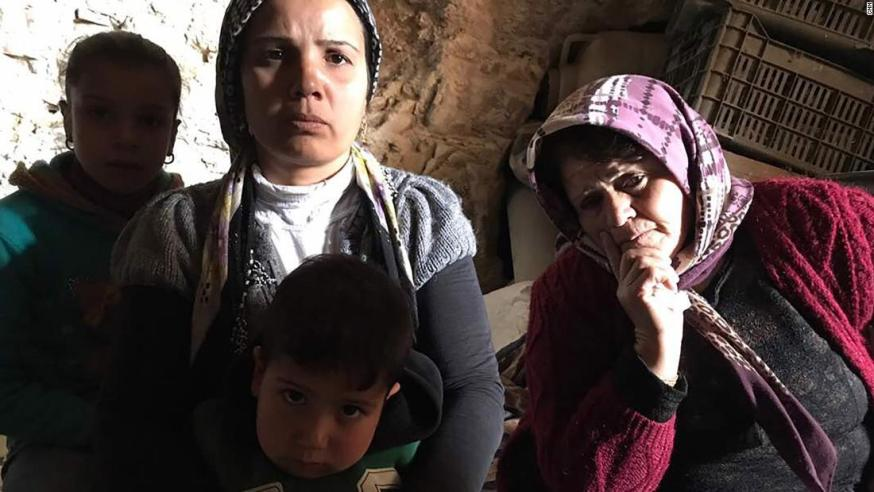 Fatima Muhammed (right), is sheltering in a cave with about a dozen others.