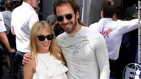 Kylie Minogue shares a moment with Jean-Eric Vergne of France ahead of the fourth round of the FIA Formula E championship in Santiago.