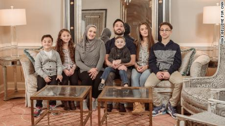 Hanadi Asad, here with her husband, Jamaal, and their five children, is trying to grow her dessert and event business at a time that feels uncertain.
