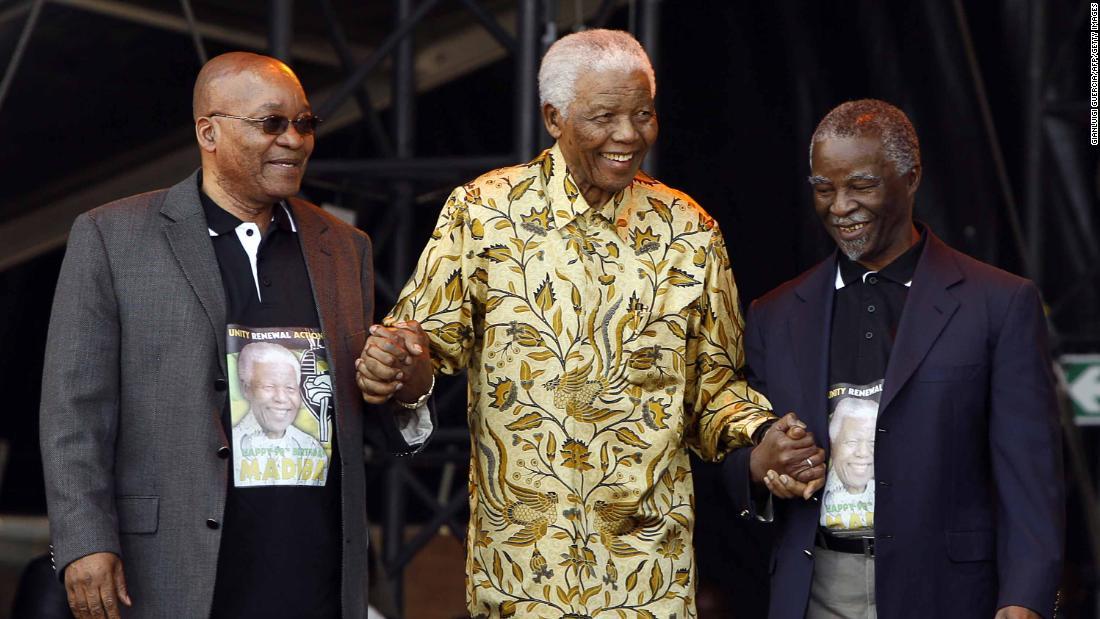 From left, Zuma, Mandela and Mbeki arrive on stage for Mandela's 90th birthday celebration in August 2008.