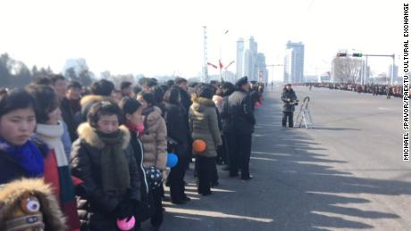 Bystanders wait for the parade to begin in Pyongyang, North Korea.