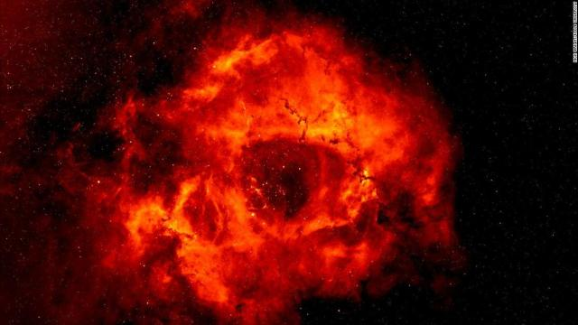The Rosette Nebula is 5,000 light-years from Earth. The distinctive nebula, which some claim looks more like a skull, has a hole in the middle that creates the illusion of its rose-like shape.