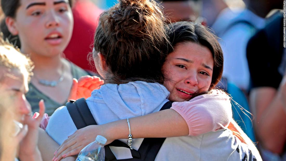 Students released from lockdown console each other. While some students were evacuated, many remained in the school until authorities could come to their aid.