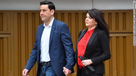 Former footballer Andy Woodward (L) arrives with his partner Zelda (R) at court on Monday.