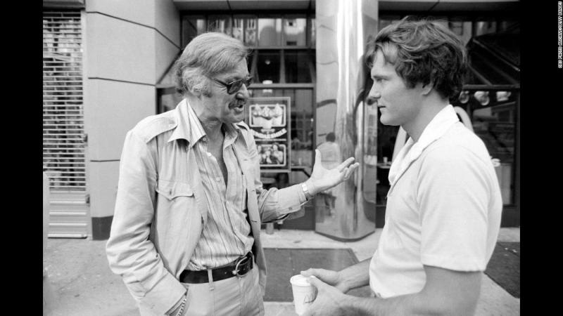 "Lee talks to actor Nicholas Hammond during the filming of the television series ""The Amazing Spider-Man"" in 1978."
