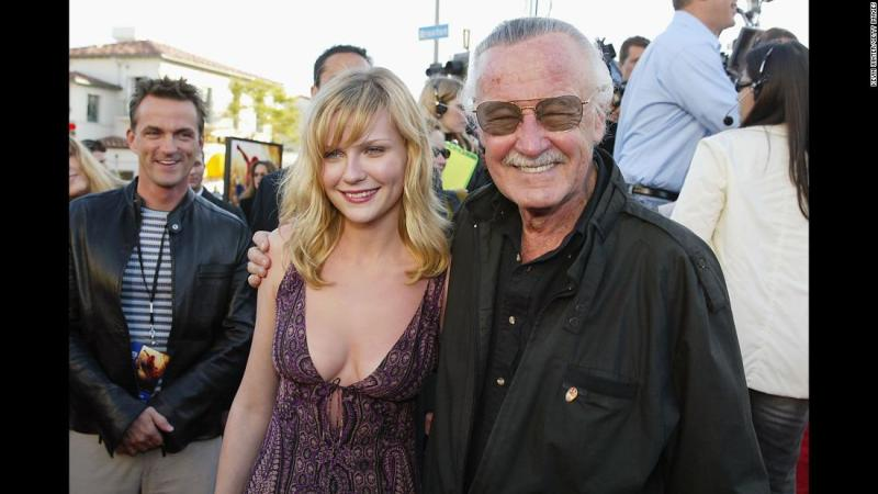 """Lee arrives with actress Kirsten Dunst for the premiere of the film """"Spider-Man"""" in 2002. Dunst played Mary Jane Watson in the film."""