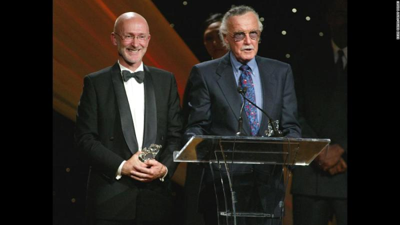 """Lee and film producer Ian Bryce accept a Faith and Values Award for the """"Spider-Man"""" film in 2003."""