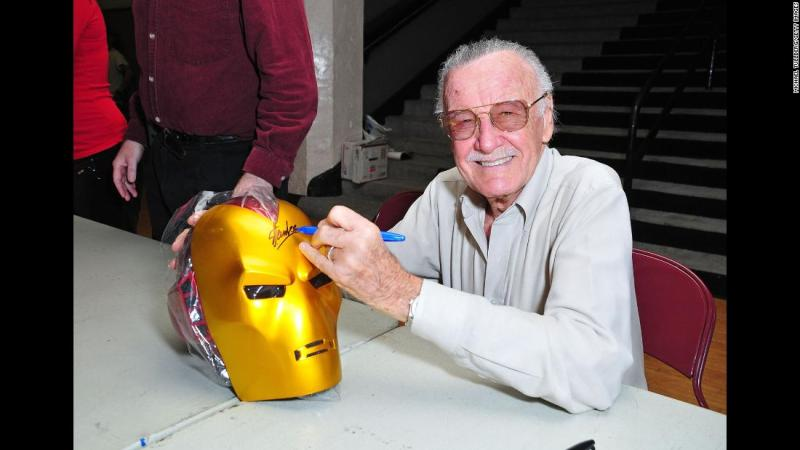 "Lee signs an ""Iron Man"" mask in 2008."