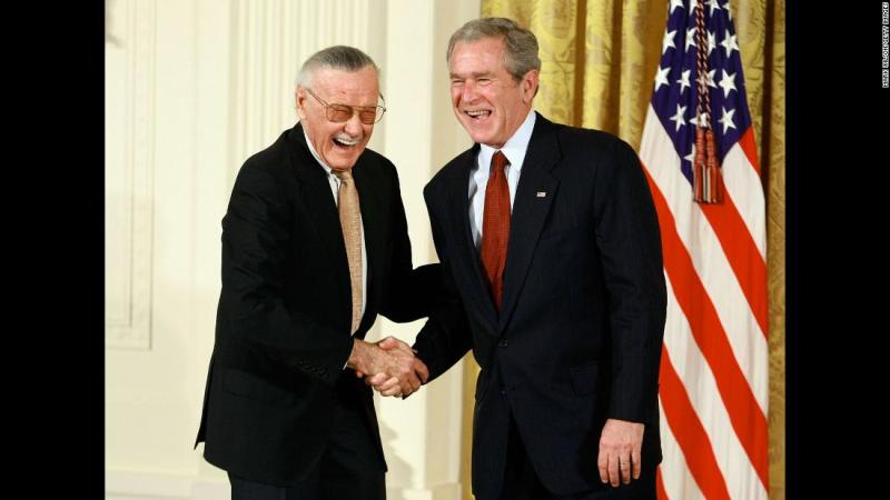Lee shakes hands with US President George W. Bush after receiving a National Medal of Arts in 2008.