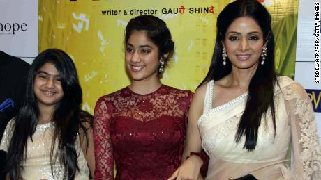 """Sridevi (R) with her daughters Jhanvi (C) and Khushi (L) in 2012 at the premiere of """"English Vinglish."""""""