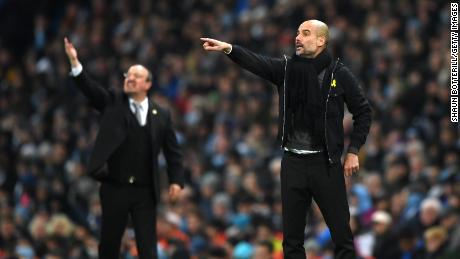 """Guardiola says he will continue to wear a yellow ribbon because he is """"a human being before being a manager."""""""