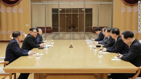 This picture released by North Korea's official Korean Central News Agency (KCNA) on March 6, 2018 shows North Korean leader Kim Jong Un (second left) meeting with the South Korean delegation. His sister Kim Yo Jong is seated next to him.