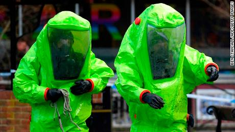 Investigators in biohazard suits at the bench where the Skripals were found unconscious.