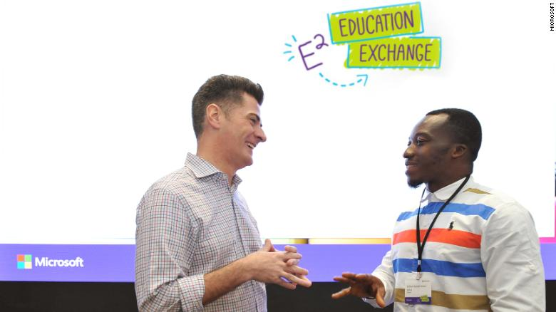 Anthony Salcito, vice president of worldwide education for Microsoft, meets with Richard Appiah Akoto.