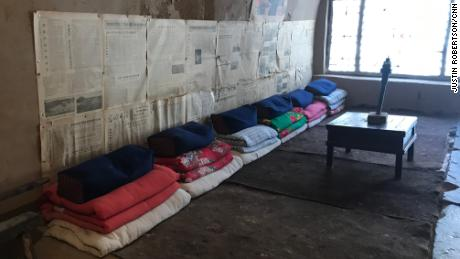 """Xi's bed (shared with five others with his spot being the second from left) in his """"cave house."""""""