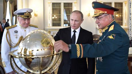 Russia warns of retaliation after at least 100 diplomats expelled worldwide