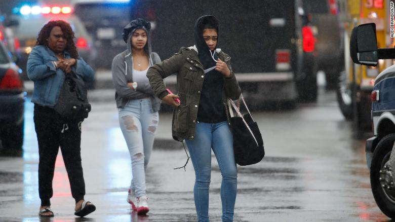 Two students and a mother leave Great Mills High School after the shooting Tuesday.