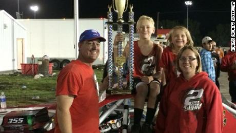 The Sharps show off a trophy after a race at Iowa's Adams County Speedway in an undated photo.