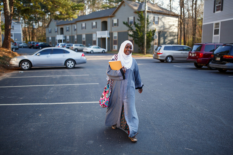 Batulo walks to school in the morning. Once she gets her GED, she hopes to study to become a nurse. (Melissa Golden/Redux for CNN)