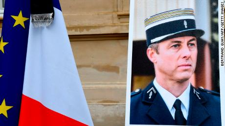 A portrait of Beltrame is pictured during  a minute of silence at the Interior Ministry in Paris.