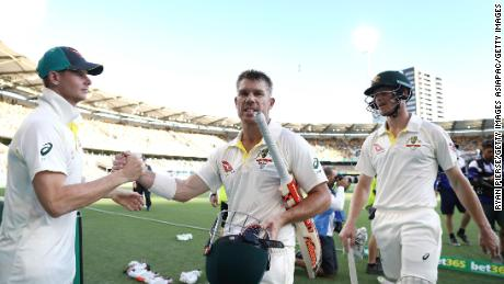 Smith congratulates  Warner and Bancroft on day four of the First Test Match of the 2017/18 Ashes Series between Australia and England at The Gabba on November 26, 2017 in Brisbane, Australia.
