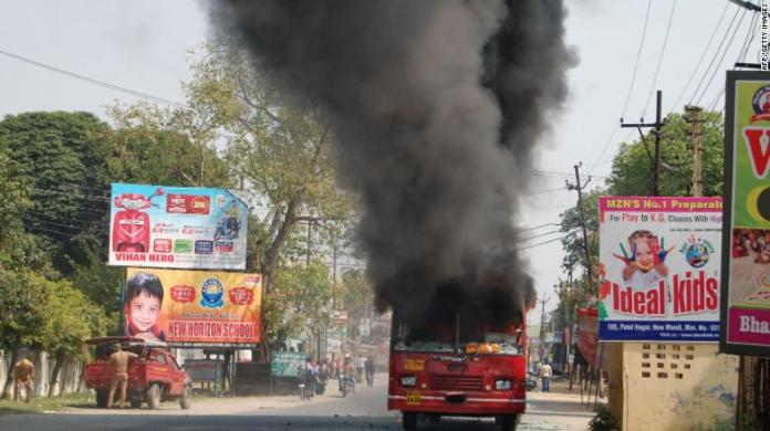 An Indian public bus burns during countrywide protests against a Supreme Court order seen as diluting protections afforded to lower castes.