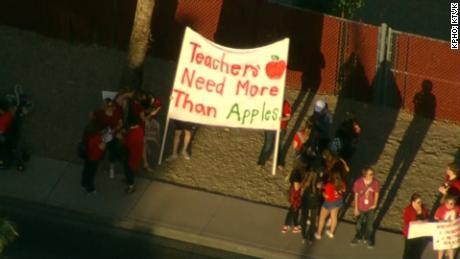 Arizona teachers hold 'walk-ins' before school to demand better pay