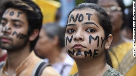 People take part in a Not In My Name protest at Parliament Street in New Dehli on April 15.