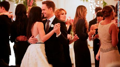 """Mike and Rachel talk down the aisle in """"Good-Bye,"""" the season 7 finale of """"Suits."""""""