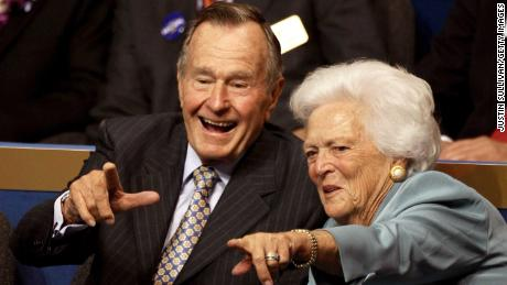 ST. PAUL, MN - SEPTEMBER 02:  Former President George H.W. Bush (L) and former first lady Barbara Bush (C) point from their seats on day two of the Republican National Convention (RNC) at the Xcel Energy Center on September 2, 2008 in St. Paul, Minnesota. The GOP will nominate U.S. Sen. John McCain (R-AZ) as the Republican choice for U.S. President on the last day of the convention.  (Photo by Justin Sullivan/Getty Images)
