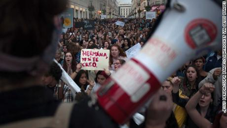 "A woman holds a placard reading, ""Sister, I believe you,"" as large crowds demonstrate in Málaga."