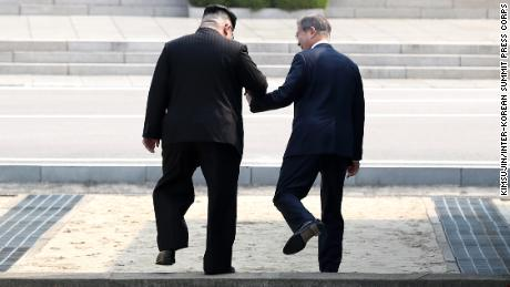 North Korean leader Kim Jong Un invites South Korean President Moon Jae-in to step into North Korea with him at their April summit.